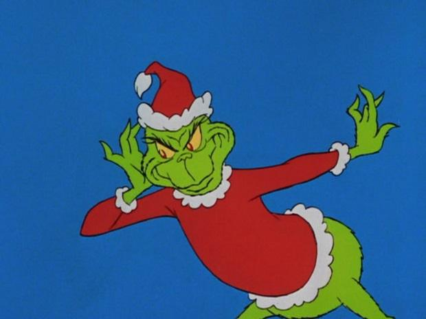 'that's a noise' grinned the Grinch, 'that i simply must hear.'  he paused, and the Grinch put a hand to his ear.